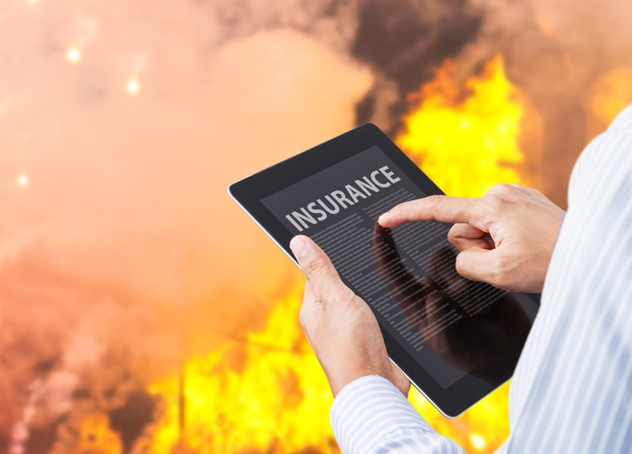 Man-pointing-at-insurance-wording-on-tablet-with-fire-background-613890948_700x502.jpeg